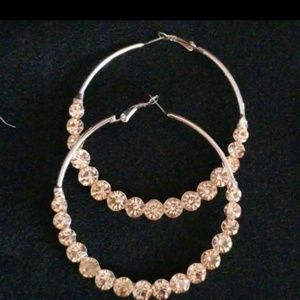 Large gold tone hoops with pink jewels